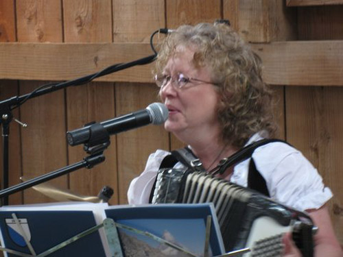 Shelby Aeppli Imholt yodels and plays the accordion